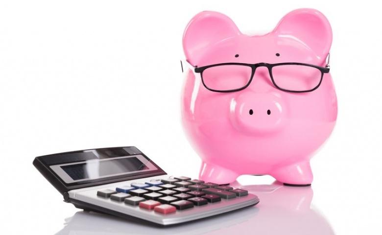 32456579 - piggybank and calculator. isolated on white background