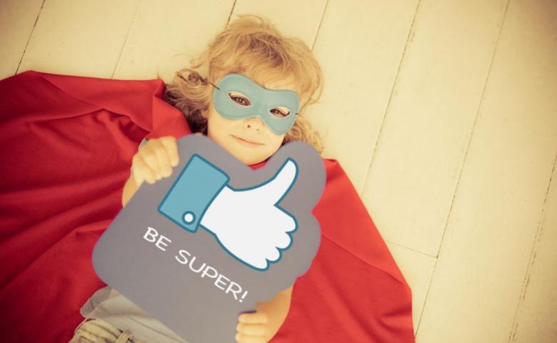 32360421 - superhero child holding like sign. social media concept. retro toned